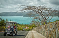 Driving around hamilton island in a golf buggy australia october two women drive to their destination buggies and complimentary Stock Image