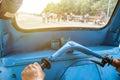 Driving blue tricycle tuk-tuk shining