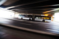 Driving bus in motion blur under a bridge Stock Image