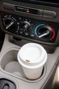 Driving with coffee ready for the long commute a travel container of Stock Images