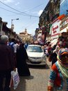 Driving through a crowded market place car drives carefully near crawford mumbai india Stock Photo