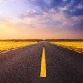 Driving on an empty asphalt road at sunset Royalty Free Stock Photo