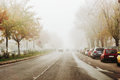 Driving in a foggy day road cars fading into the fog Stock Image