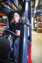 Driving a forklift Royalty Free Stock Photo