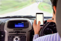 Driving while holding a mobile phone cell phone use while driving Royalty Free Stock Photography