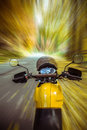 Driving a motorbike in autumn scenery motorcycle in motion Stock Photo