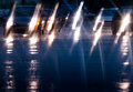 Driving in the rain defocused traffic viewed through a car windscreen Stock Photos