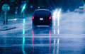 Driving in rain looking through car windshield to night road Stock Image