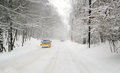 Driving thick snow covered road oncoming plow Royalty Free Stock Images