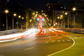 Driving thru busy intersection at night Royalty Free Stock Photo