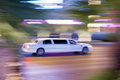 Driving white stretch limousine Royalty Free Stock Photo
