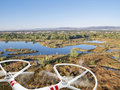 Drone flying over lakes and swamp rotating propellers of a helicopter lake landscape in northern colorado Stock Image