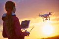 Drone flying at sunset Royalty Free Stock Photo