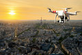 Drone with high resolution digital camera flying over Paris city Royalty Free Stock Photo