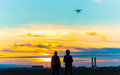 Drone over the Village at cloudy Sunset with his Pilot Royalty Free Stock Photo