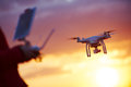 Drone pilotage at sunset Royalty Free Stock Photo