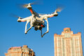 Drone quad copter with digital camera flying over the city Royalty Free Stock Photo