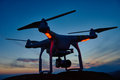Drone quadrocopter with digital camera at sunset Royalty Free Stock Photo
