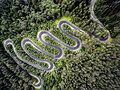 Drone view of a curvy road in Romania