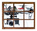 Drones privacy invasion concept and blurred oversized drone flying with a camera outside the window Stock Photo