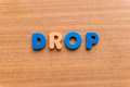 Drop colorful word on the wooden background Stock Photos