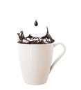 Droplet and splash of black chocolate in big cup isolated on white background food drink Royalty Free Stock Image