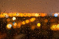 Droplets of night rain on window Royalty Free Stock Photo
