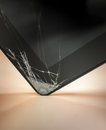 Dropped and cracked tablet computer then the glass surface at the corner Stock Images