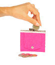 Dropping a coin into a pink purse Royalty Free Stock Images