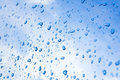 Drops on blue car mirror sky as a background Stock Photography