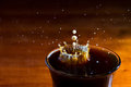 Drops of milk splashing in a cup of coffee high speed Royalty Free Stock Image