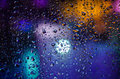 Drops of night rain on window, abstract background Royalty Free Stock Photo