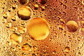Drops of oil and air bubbles on water Royalty Free Stock Photo