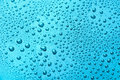 Drops of water on a color background. Light blue Royalty Free Stock Photo