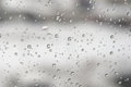 Drops of water on the window a winter raining day shallow dof Royalty Free Stock Photo
