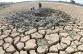 Drought in indonesia residents took the murky waters of the well made the middle of the reservoir dries up for daily necessities Royalty Free Stock Photo
