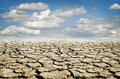 Drought land receding into the distance dry cracked earth Royalty Free Stock Images