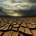 Drought land and storm clouds Royalty Free Stock Photography