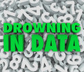 Drowning in data too much overwhelming information the words on a sea of numbers illustrating an overabundance of numbers that are Royalty Free Stock Photo