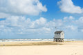 Drowning house at the beach from dutch wadden island terschelling Stock Photos