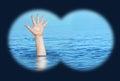 Drowning man needs help view through binoculars Royalty Free Stock Photo