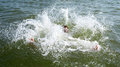 Drowning man trying to swim out of the ocean Royalty Free Stock Photo