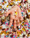 Drowning in pills Stock Photo