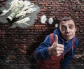 Drug addict showing thumb up Royalty Free Stock Photo