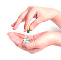 Drug capsules and pills in hand Royalty Free Stock Photo