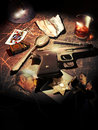 Drug enforcement on a grunge wooden table an automatic gun bullets and a police badge close to several objects representing the Royalty Free Stock Photography