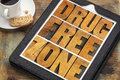 Drug free zone in wood type word abstract vintage letterpress on a digital tablet with a cup of coffee Royalty Free Stock Photo