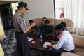 Drug raid police conducted a at a motel in karanganyar central java indonesia to suppress crime Royalty Free Stock Images