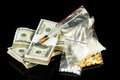 Drug syringe and heroin with pills over money Royalty Free Stock Images