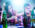 Drug using teens at house party packing bongs and rolling up joints to use drugs Royalty Free Stock Photos